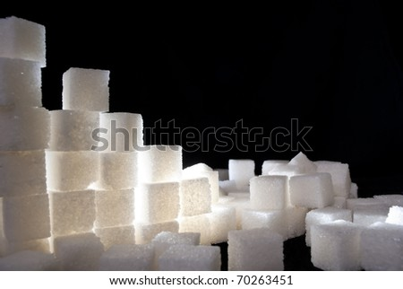 a ruined wall from white sugar bricks - stock photo