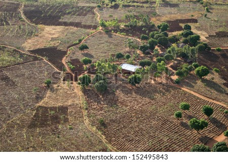 A rural farmstead in Africa, viewed from the air. - stock photo
