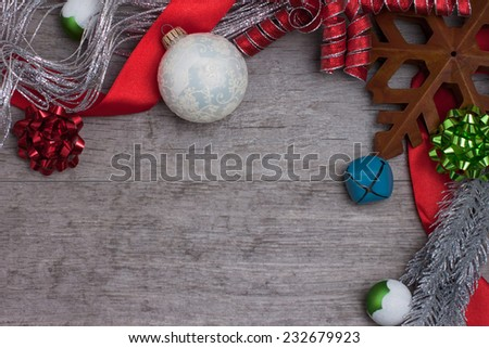 A rustic star and ornaments on a weathered wooden table - stock photo