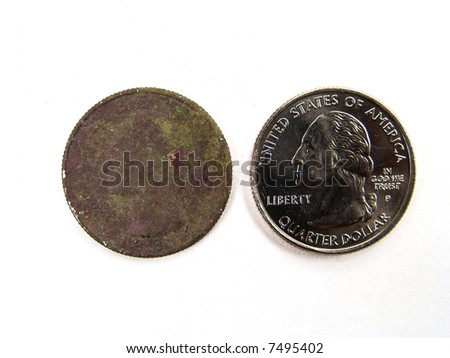 A rusty and a new United States quarter dollar macro close-up - stock photo