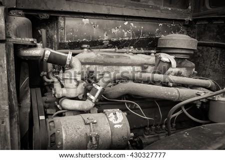 A rusty and dirty old bus engine. - stock photo