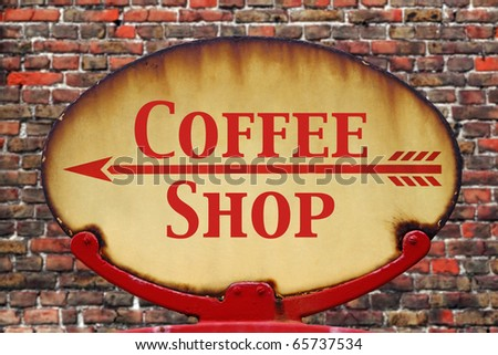 A rusty old retro arrow sign with the text Coffee shop - stock photo