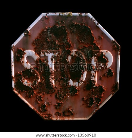 A rusty STOP signal isolated on black - stock photo