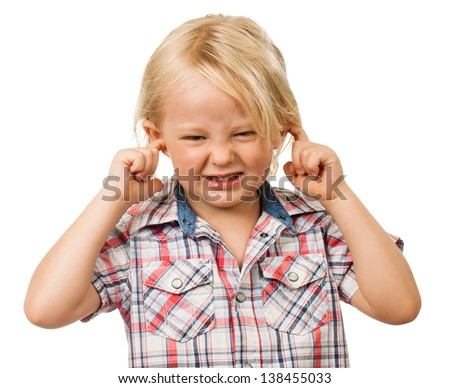 A sad boy looking distressed and blocking his ears with his fingers. Isolated on white. - stock photo