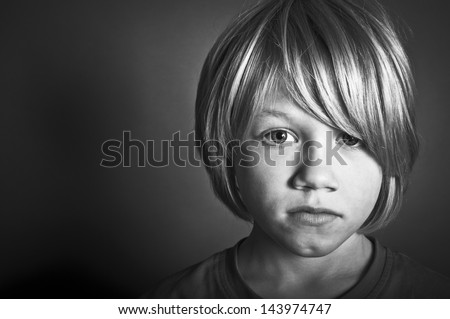 A sad boy with an upset expression - stock photo