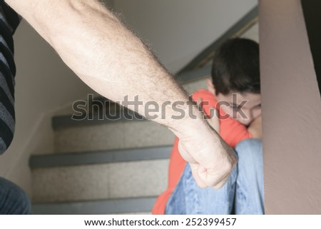 A sad child on the side of staircase. - stock photo