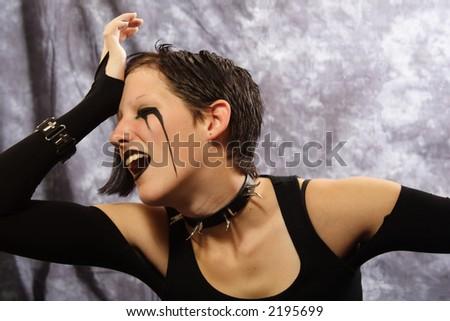 A sad, grief-stricken goth girl. - stock photo