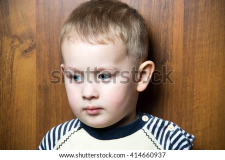 a sad  young caucasian boy. looking away - stock photo
