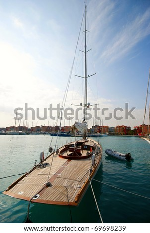 A sailing yacht tied up in a marina - stock photo