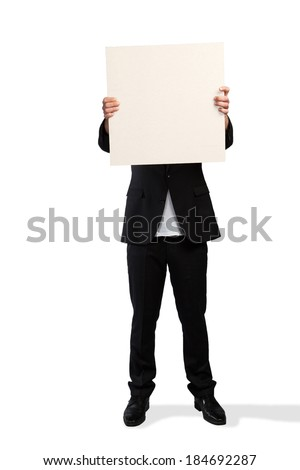 A Sales Director is hidden behind a white clipboard. - stock photo