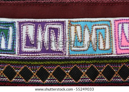 A sample of woven ethnic cloth fabric taken in close up. Fabric is woven by a minority tribe living in the mountainous regions of Thailand and China - stock photo