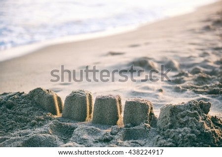 A sandy beach in sunset light - detail with sand cakes - stock photo