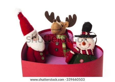 A santa, snowman, Rudolph deer dolls in a opened red heart(love) box for christmas(xmas) isolated white. - stock photo