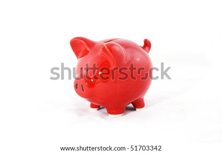 A saving piggy on a white background. - stock photo