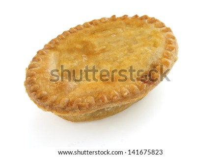 A savoury meat pie with a golden crust studio isolated - stock photo