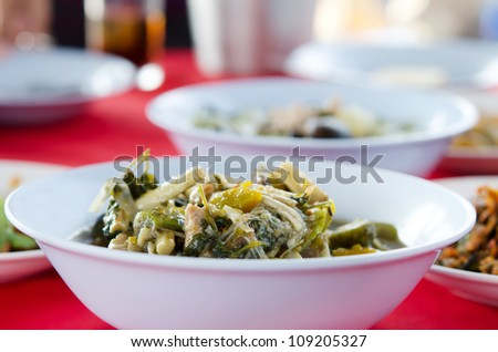 A savoury thick soup made from spices and vegetables on  red table - stock photo