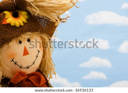 A scarecrow head on a sky background, scarecrow - stock photo