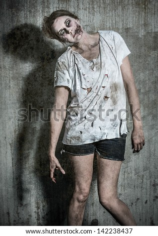 a scary and bloody zombie girl - stock photo