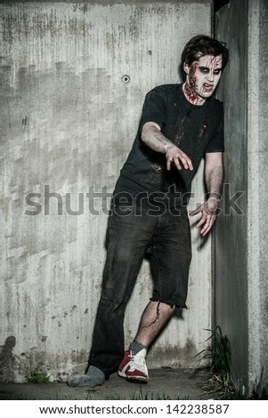a scary and bloody zombie man - stock photo