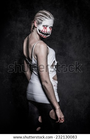 a scary demon woman with big sharp teeth - stock photo