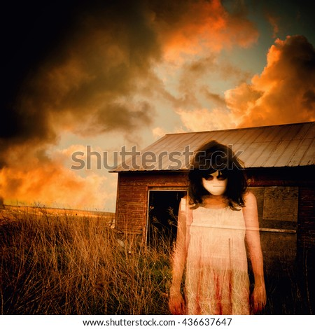 A scary ghost girl is wearing a white dress and an abandoned house shed is in the background with storm clouds for a fear or nightmare concept - stock photo