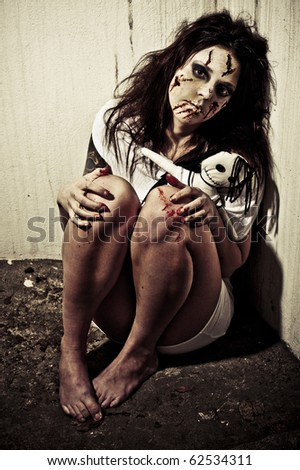 a scary looking girl possessed by a demon - stock photo