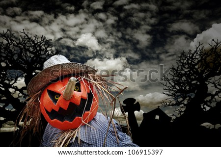 A scary pumpkin head jack-o-lantern at midnight in an eerie background for Halloween concept. - stock photo