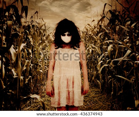 A scary woman ghost is wearing an old white dress in a dark corn field background for a horror Halloween theme concept. - stock photo