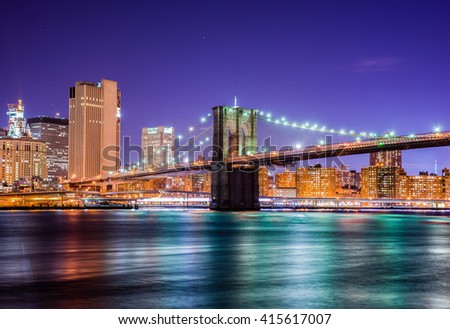 A scenic night view of the Brooklyn Bridge from the Brooklyn Bridge Park in New York - stock photo