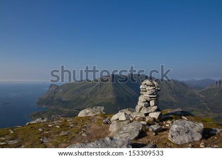 A scenic photo of some mountain top on mountain peak background  - stock photo