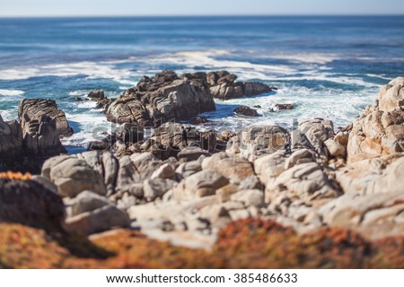 A scenic rocky beach through Pebble Beach and Pacific Grove on the Monterey Peninsula in California. Tilt-shift photography for blurry and miniature effect.  - stock photo