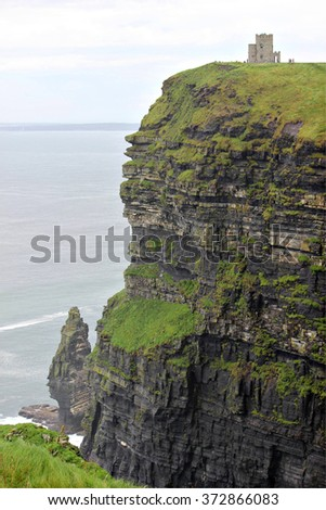 A scenic view of O'Brien's Tower above the Cliffs of Moher in Clare County, Ireland. - stock photo