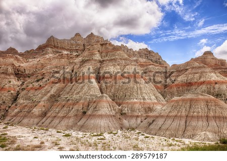 A scenic view showing the natural colors and the erosion in the hills of the Badlands National Park in South Dakota. - stock photo