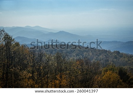 A scenic vista looking out over the Appalachian Mountains during peak autumn color. - stock photo