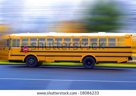 A school bus speeding on a local rad - stock photo