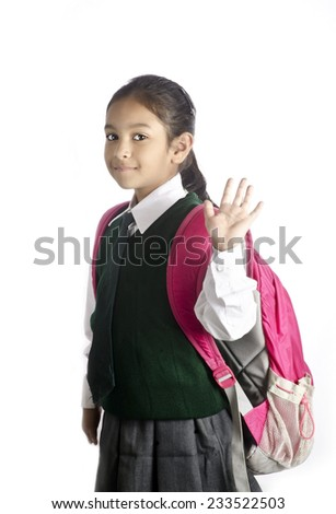 A school girl saying bye before going to school - stock photo