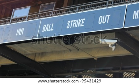 A scoreboard at a baseball field prior to the start of the game. - stock photo