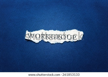 A scrap of paper with the word workgroup - stock photo
