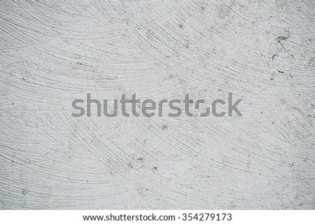 A scratched stone surface as a background texture - stock photo