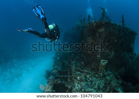 A scuba diver in deep blue of indian ocean. Picture take in Ari atoll - Maldives. - stock photo