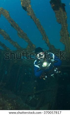 A scuba diver inside a shipwreck Dori in Azores islands. - stock photo