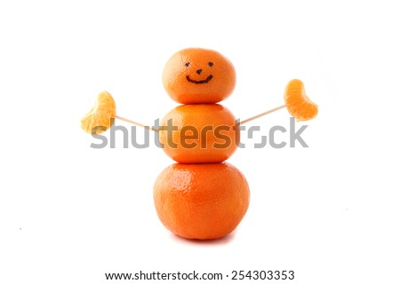 A sculpture made of clementine tangerine oranges representing a happy healthy person. - stock photo