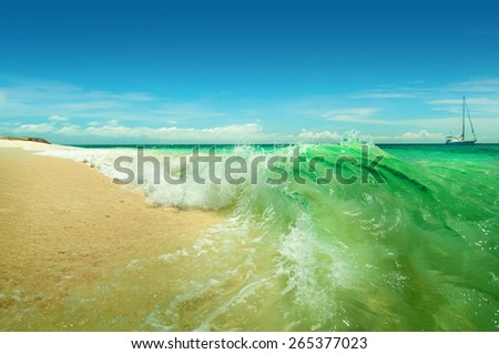 A sea landscape with turquoise waves and yacht - stock photo