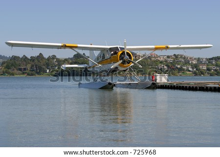 A seaplane floats on standby. - stock photo