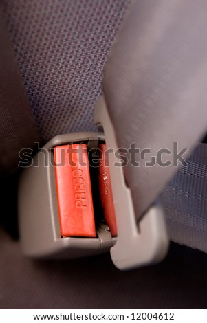 A seatbelt in a car with cloth seats - stock photo