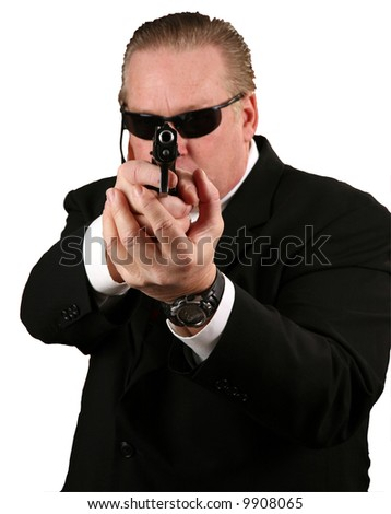"""a Secret Service Agent points his weapon at YOU the Viewer """"isolated on white"""" - stock photo"""