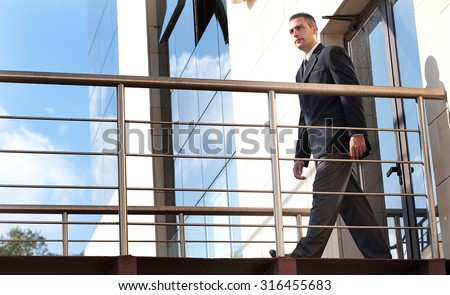a security guard in do his patrol in  a outdoor corridor of a building - stock photo