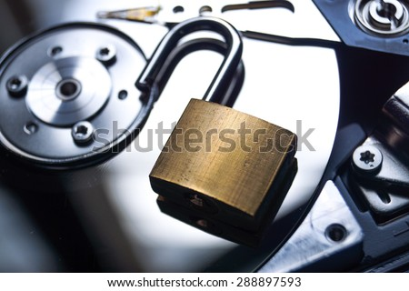 A security lock on computer hard disk / Computer data security breach - stock photo
