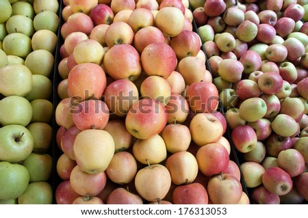 A selection of apples at the market - stock photo