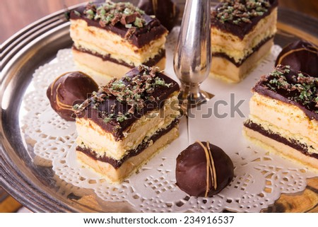A selection of delicious desserts arranged and served on a silver cake stand in an english high tea style. - stock photo